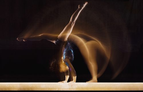 Gymnast Doing Cartwheel on Balance Beam